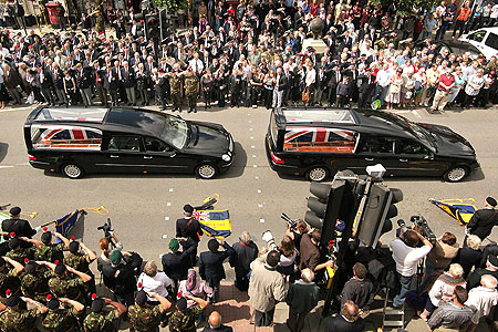 Sombre: Tuesday's funeral cortege for Cpl Etchells and others
