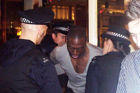 Ledley King struggles with police outside Punk nightclub