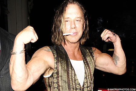 Mickey Rourke shows his fans his biceps
