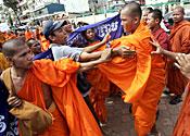 Buddhist monks fighting