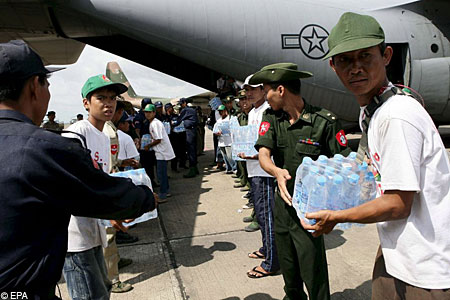 Burmese soldiers carry water supplies
