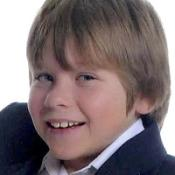 A woman is being questioned over the death of Sam Riddall in a hit-and-run incident