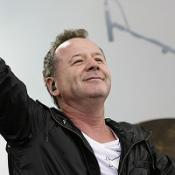 Simple Minds will play a track in memory of John Hughes