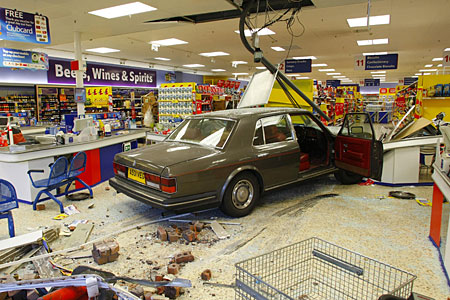 Scene of havoc: The Rolls Royce after it smashed into Tesco