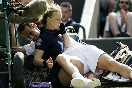 Michael Llodra gets up close and personal with a ballgirl