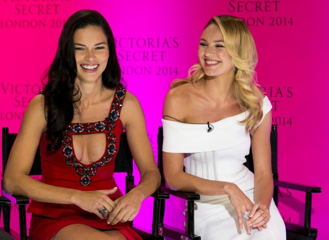 We're coming! Adriana Lima and Candice Swanepoel announce that the Victoria's Secret show is coming to London this morning (Picture: John Phillips/Invision/AP)