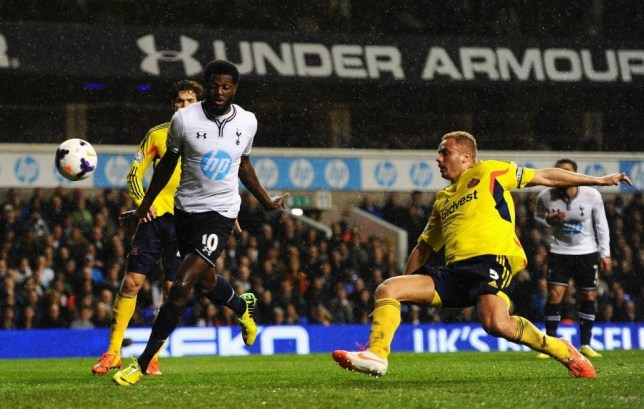LONDON, ENGLAND - APRIL 07: Emmanuel Adebayor of Tottenham Hotspur scores his team's first goal during the Barclays Premier League match between Tottenham Hotspur and Sunderland at White Hart Lane on April 7, 2014 in London, England.  (Photo by Mike Hewitt/Getty Images)