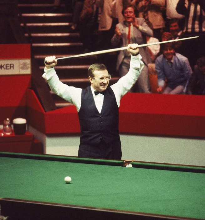 May 1985:  Dennis Taylor of Northern Ireland celebrates victory in the Embassy World Snooker Championship Final at the Crucible Theatre in Sheffield, England. Taylor beat Steve Davis 18-17 in a dramatic black ball finish.  Mandatory Credit: Adrian Murrell /Allsport