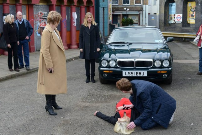 WARNING: Embargoed for publication until: 01/04/2014 - Programme Name: EastEnders - TX: 11/04/2014 - Episode: Eastenders - 4836 (No. 4836) - Picture Shows: ***HOLD BACK FOR COMMS... Shirley glares at Ronnie when her car hits Lola.  Shirley Carter (LINDA HENRY), Ronnie Mitchell (SAMANTHA WOMACK), Lola Pearce (DANIELLE HAROLD), Jay Mitchell (JAMIE BORTHWICK) - (C) BBC - Photographer: Kieron McCarron