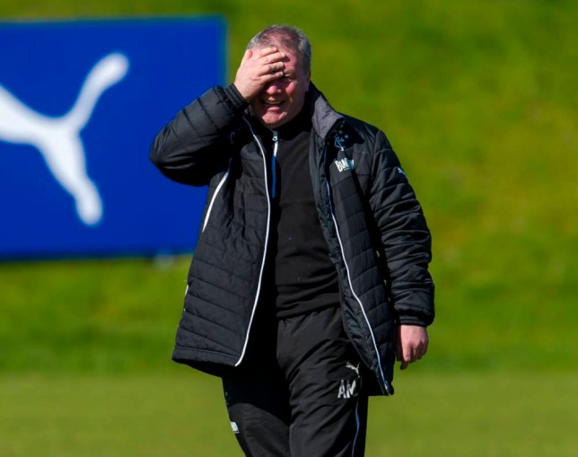 14/04/14 RANGERS TRAINING MURRAY PARK - GLASGOW Rangers manager Ally McCoist is all smiles as he arrives for training