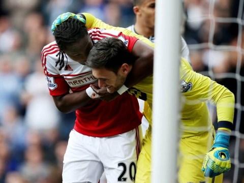 Hugo Rodallega puts Hugo Lloris in a friendly headlock after superb save denies Fulham man
