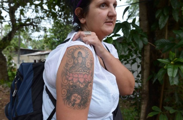 An unidentified British tourist poses for a photograph to display a tattoo of the Buddha on her upper arm in Colombo on April 22, 2014. Sri Lanka has detained a female British tourist for having a Buddha tattoo on her right arm and ordered her deportation, police said. The unidentified woman was arrested at the country's main international airport and appeared before a magistrate who ordered her deportation, police said in a statement.  AFP PHOTO / LAKRUWAN WANNIARACHCHILAKRUWAN WANNIARACHCHI/AFP/Getty Images