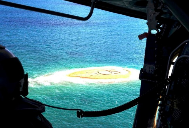 Over here: The view from the rescue helicopter shows the SOS on a sand bar near Mackay, Queensland (Picture: EPA)