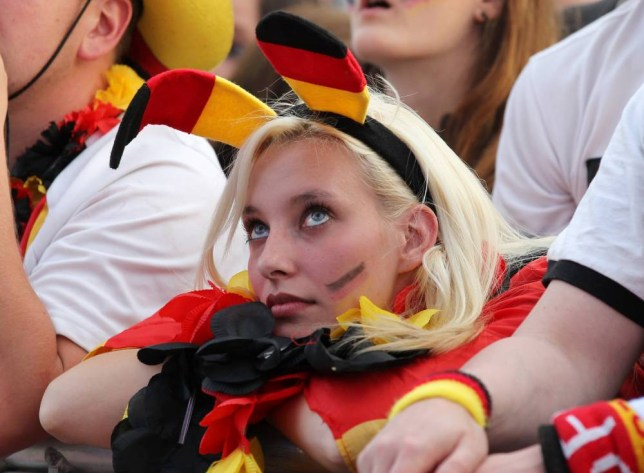 BERLIN, GERMANY - JUNE 22:  A supporter of Germany watch the UEFA EURO 2012 quarter final match between Germany and Greece at a public viewing zone called 'fan mile' near the Brandenburg Gate on June 22, 2012 in Berlin, Germany.  (Photo by Matthias Kern/Getty Images)