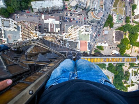 They're just crane crazy: Meet the 'skywalkers' scaling dizzying heights – without safety gear