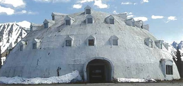 This undated photo provided by Brad Fisher, shows an urethane igloo is seen in Anchorage, Alaska. The igloo, an embodiment of an Alaska cliche, and a must-stop for tourists heading for Denali National Park and Preserve, is for sale. The 80-foot high structure, erected more than four decades and never completed, sits on a 38-acre site, which is part of the sales package. (AP Photo/Brad Fisher)