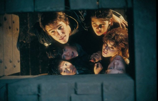 Film: THE GOONIES (1985), Starring Jonathan Ke Quan as Ke Huy Quan, Sean Astin as Mikey, Josh Brolin as Brand, Corey Feldman as Mouth, Kerri Green as Andy and Martha Plimpton as Stef.   BKB4DN