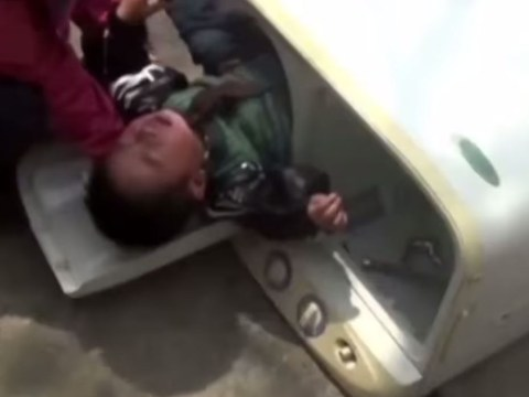 Toddler climbs into washing machine for toy, gets stuck