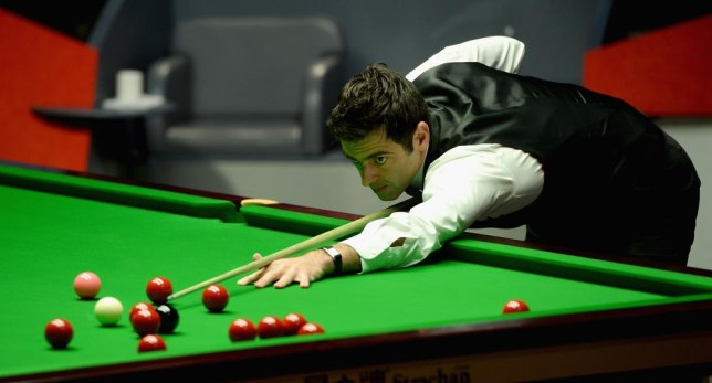 SHEFFIELD, ENGLAND - MAY 04: Ronnie O'Sullivan plays a shot against Mark Selby during The Dafabet World Snooker Championship final at Crucible Theatre on May 4, 2014 in Sheffield, England. Gareth Copley/Getty Images