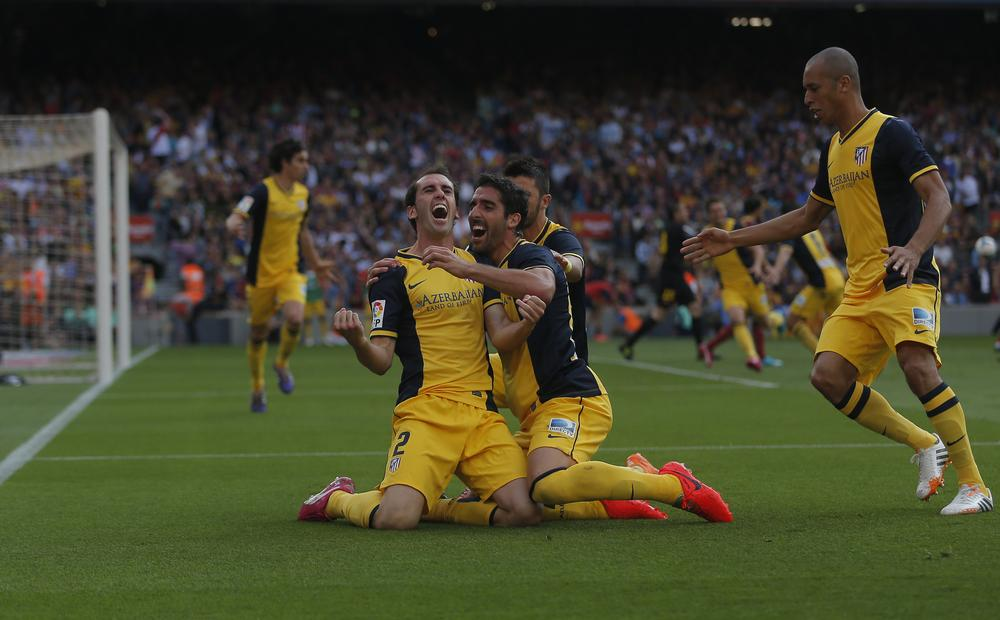 Diego Godin silences Barcelona and hands Atletico Madrid the title