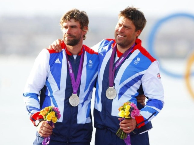 Iain Percy, left, and Andrew Simpson receive their silver medals in London two years ago (Picture: PA)