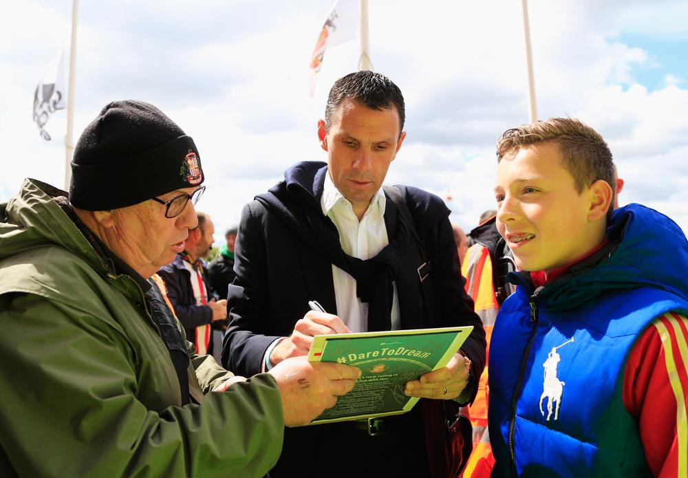 SUNDERLAND, ENGLAND - MAY 11: Gus Poyet manager of Sunderland signa autographs prior to the Barclays Premier League match between Sunderland and Swansea City at Stadium of Light on May 11, 2014 in Sunderland, England. Paul Thomas/Getty Images