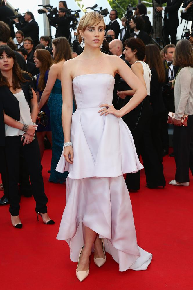 Suki wore a pretty tiered pale pink dress for her first red carpet event at the Festival on Sunday (Picture: Vittorio Zunino Celotto/Getty Images)