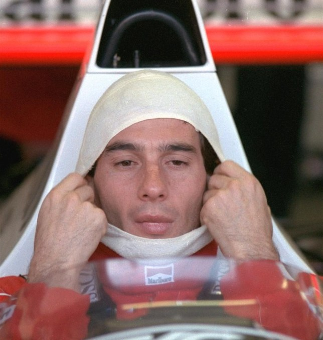 FILE - In this November 4, 1989, file photo, Brazilian driver Ayrton Senna, in a McLaren Honda, pulls on a fire resistant mask before going out to practice for the Australian Grand Prix. Senna won three Formula One titles — in 1988, 1990 and '91 — all with McLaren. He moved to the Williams team for his tragic 1994 season. Despite his career being cut short when he was 34, his 41 wins stand third all-time behind Michael Schumacher's 91 and rival Alain Prost's 51. He died at the 1994 San Marino Grand Prix. (AP Photo/Stephan Holland, File) AP Photo/Stephan Holland, File