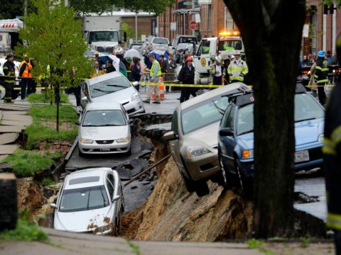 Hole-y moley: Giant sinkhole swallows Baltimore street
