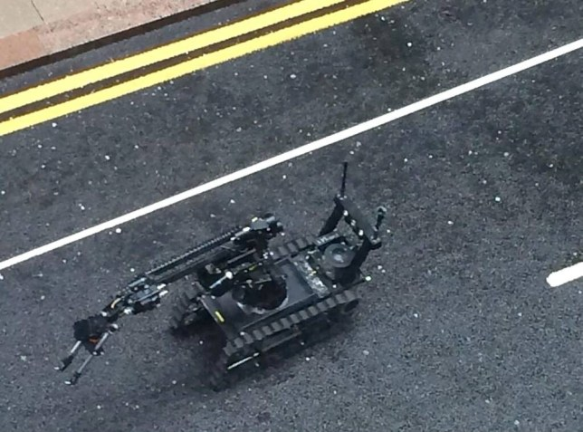 MANDATORY CREDIT: Robbie Sargent/Rex Features. *This is a copyright cleared picture*  Mandatory Credit: Photo by Robbie Sargent/REX (3728120a)  Bomb disposal robot sent to investigate suspicious package  Suspect package in Canary Wharf, London, Britain - 01 May 2014  MANDATORY CREDIT: Robbie Sargent/Rex Features. *This is a copyright cleared picture*  Canary Wharf was in lockdown this morning after reports of a suspected package near Barclays building. There are reports that a controlled explosion has now been carried out.