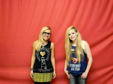Most awkward meet and greet photos EVER? These Avril Lavigne fans should probably demand their money back…