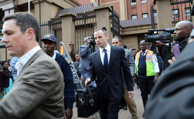 Cries: Oscar Pistorius, center, leaves court after the case is adjourned for the day in Pretoria (Picture: AP)