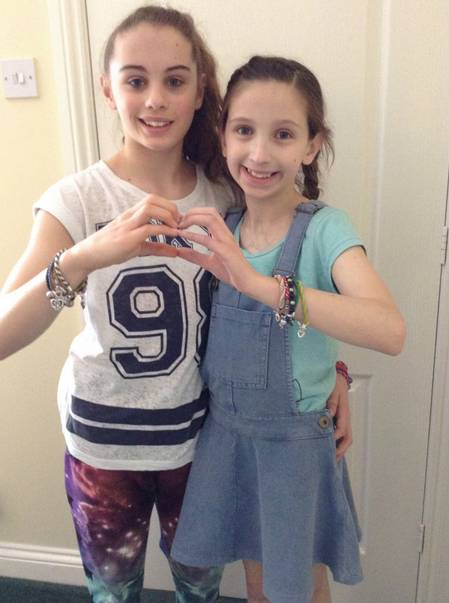 Rachel and her sister Kate. Eve Hooley, 41, of Cramlington, the mother of a little girl who was facing total cardiac failure, has spoken of her ëindescribable gratitudeí towards an unknown family who donated a heart to her daughter Rachel just in time for her eighth birthday.