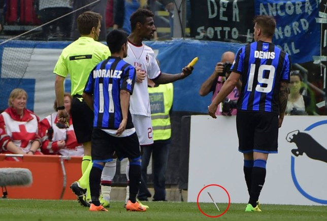 AC Milan's French defender Kevin Constant (C) shows a banana thrown on the pitch by football fans during the Italian Serie A football match Atalanta vs AC Milan on May 11, 2014 at the Atleti stadium in Bergamo.  AFP PHOTO / OLIVIER MORINOLIVIER MORIN/AFP/Getty Images