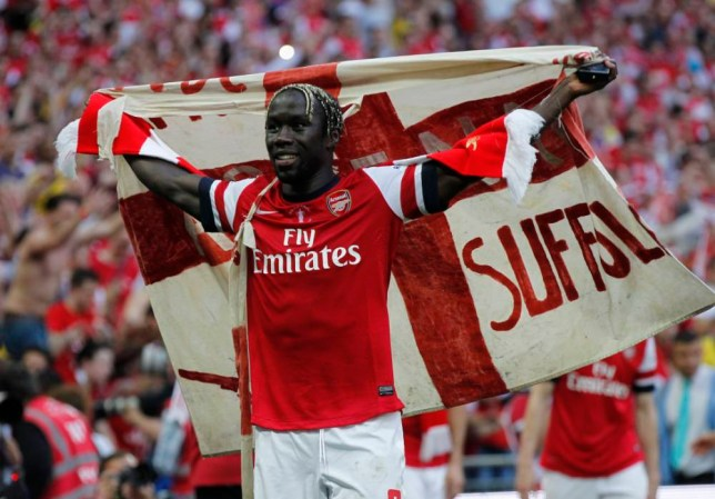 Arsenal's Bacary Sagna celebates their win against Hull City at the end of their English FA Cup final soccer match at Wembley Stadium in London, Saturday, May 17, 2014. (AP Photo/Sang Tan)
