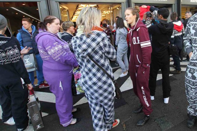 OnePiece Jumpsuits - Fans of the 'onesie' gather at the Boxpark Retail Mall for the opening of the OnePiece store..n. REXMAILPIX.