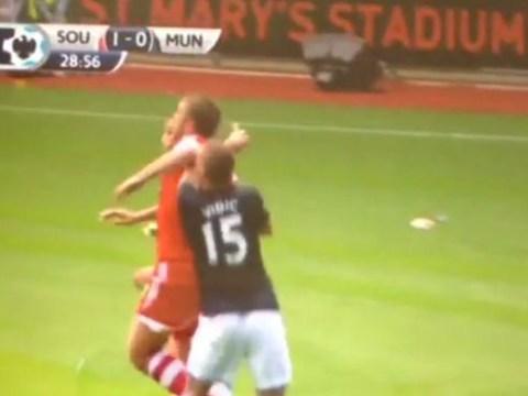 Rickie Lambert elbows Nemanja Vidic before scoring Southampton goal