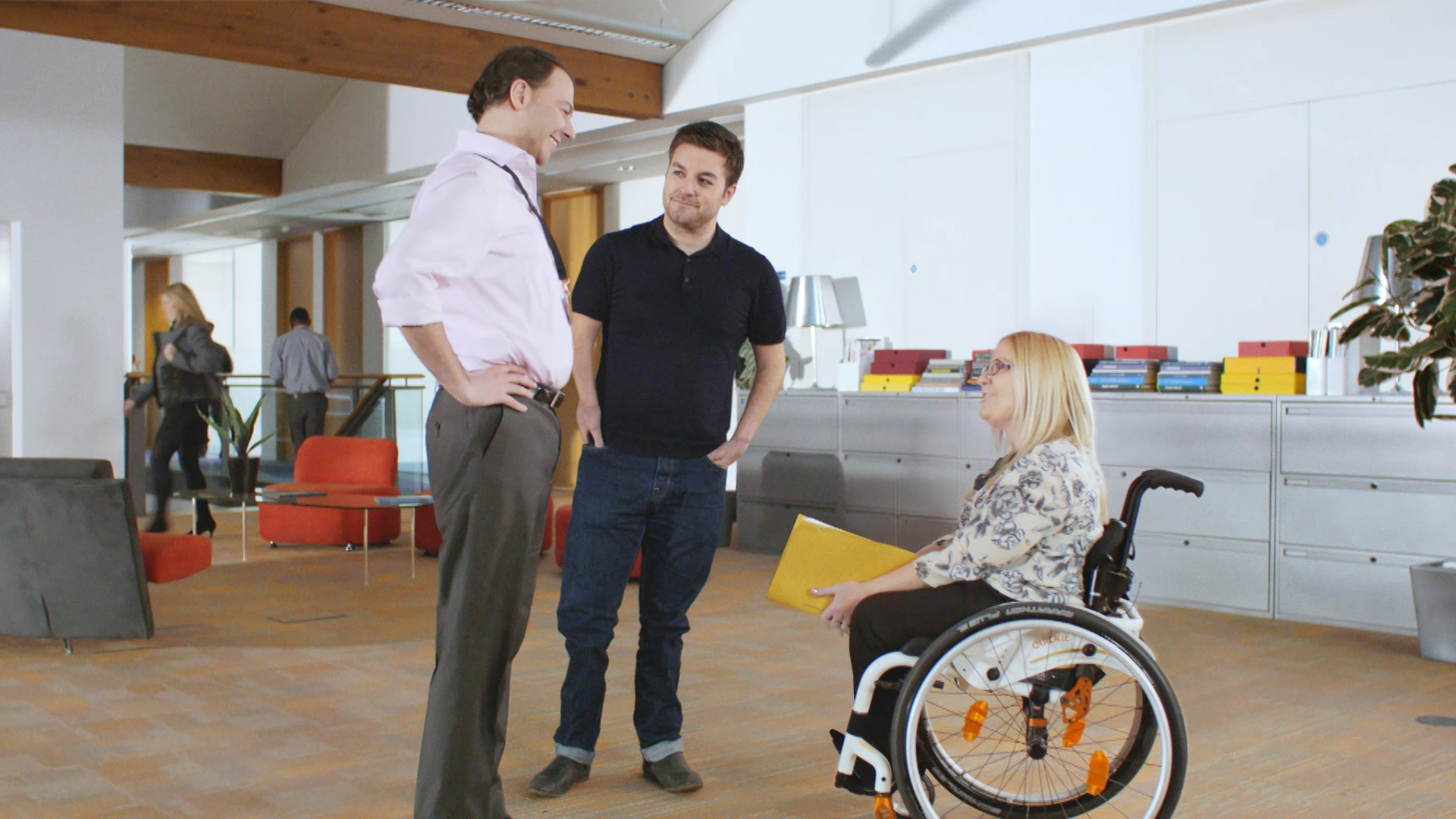 Alex Brooker, centre, and Julie Fernandez, right, in one of the new End the Awkward adverts (Picture: Scope)