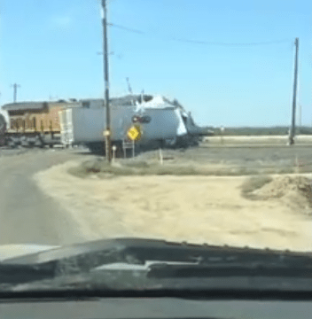 Speeding train smashes lorry in two at level crossing