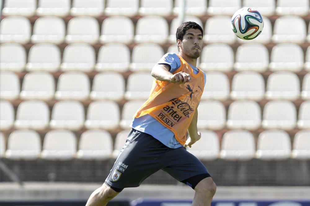 Can Liverpool still defend Luis Suarez after World Cup bite?