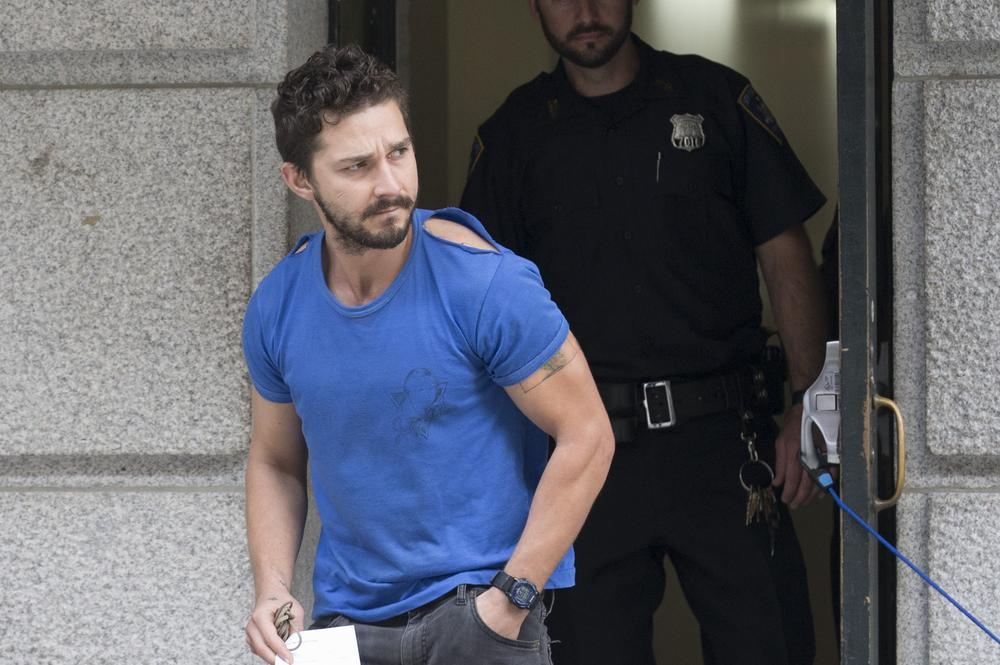 "Actor Shia LaBeouf leaves Midtown Community Court after being arrested the previous day for yelling obscenities at the Broadway show ""Cabaret,"" Friday, June 27, 2014, in New York. The 28-year-old star of the ""Transformers"" franchise faces charges that include disorderly conduct and criminal trespass. (AP Photo/John Minchillo) AP Photo/John Minchillo"