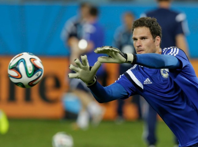 Bosnia goalkeeper Asmir Begovic catches a ball during a training session at the Arena Pantanal in Cuiaba, Brazil, Friday, June 20, 2014. Bosnia plays in group F of the Brazil 2014 soccer World Cup. (AP Photo/Fernando Llano) AP Photo/Fernando Llano