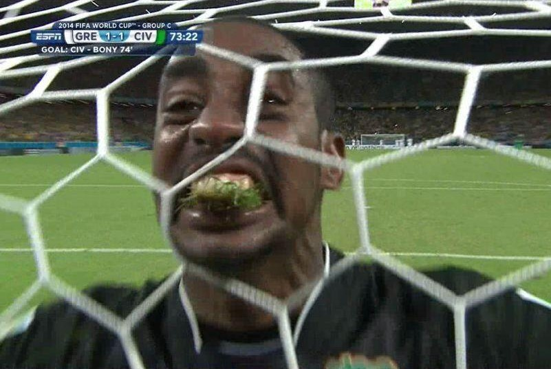 Yuck! Ivory Coast goalie Boubacar Barry caught eating grass during World Cup match
