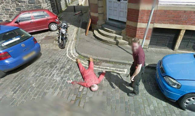 NO BROADCAST/ONLINE USE BEFORE 1PM A scene on a street in Edinburgh where jokers Dan Thompson (on the ground),56, and Garry Kerr (with bat),31, were caught on Street View pretending to commit a murder.  See SWNS story SWGOOGLE; Google Street View - infamous for capturing couples in flagrante and prostitutes working the streets - has now seemingly caught the image of a murder in Scotland's capital. One shocked user of the website - which shows panoramic views of the world's streets - called police to report an apparent killing he spotted in Leith, Edinburgh.  Officers from Police Scotland were sent out to investigate the brutal crime, but soon discovered the ruthless killer and his lifeless victim were actually a pair of mischievous mechanics.  The pair had staged the fake homicide as a joke when Google's camera car passed by their garage on Giles Street.