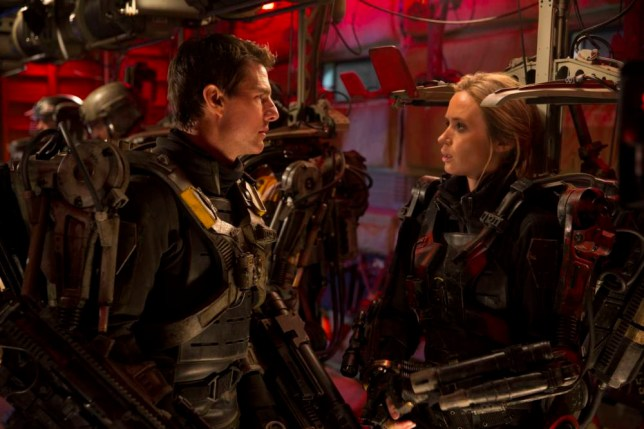 """This image released by Warner Bros. Pictures shows Tom Cruise, left, and Emily Blunt in a scene from """"Edge of Tomorrow."""" (AP Photo/Warner Bros. Pictures, David James)"""