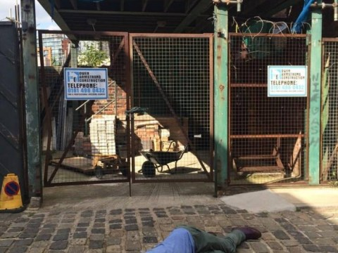 Recreating Tina McIntyre's fatal fall onto the Corrie cobbles is a popular tourist game now
