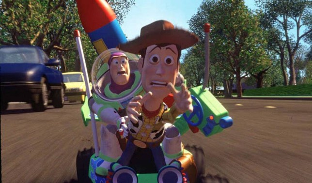 Toy Story: Woody the Cowboy and Buzz Lightyear racing along in Disney film,