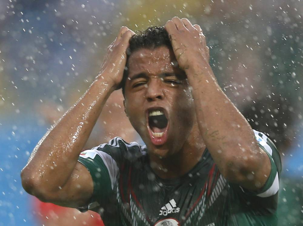 Mexico's Giovani Dos Santos gestures after he was caught offside for the second time during their 2014 World Cup Group A soccer match against Cameroon at the Dunas arena in Natal June 13, 2014.       REUTERS/Toru Hanai (BRAZIL  - Tags: SOCCER SPORT WORLD CUP)
