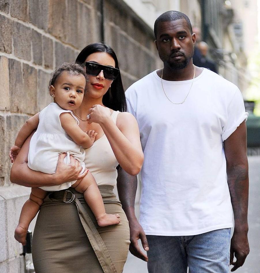 Mandatory Credit: Photo by Startraks Photo/REX (3825796bi)  Kim Kardashian and Kanye West with Daughter North West  Kim Kardashian and Kanye West out and about, New York, America - 15 Jun 2014  Kim Kardashian and Kanye West out with Baby North West in Soho on her Birthday