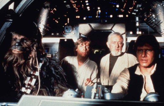 Film 'STAR WARS'--Han Solo (HARRISON FORD), Ben Kenobi (ALEC GUINNESS [DEAD 06/08/2000]), Luke Skywalker (MARK HAMILL) and Chewbacca, the Wookie, are suprised by the awesome size of the Death Star in 'STAR WARS SPECIAL EDITION.' FOR FURTHER INFORMATION CONTACT KATE BRADFORD AT FOX ON 0171 437 7766...SWSE-C-7-THE FALCON CREW